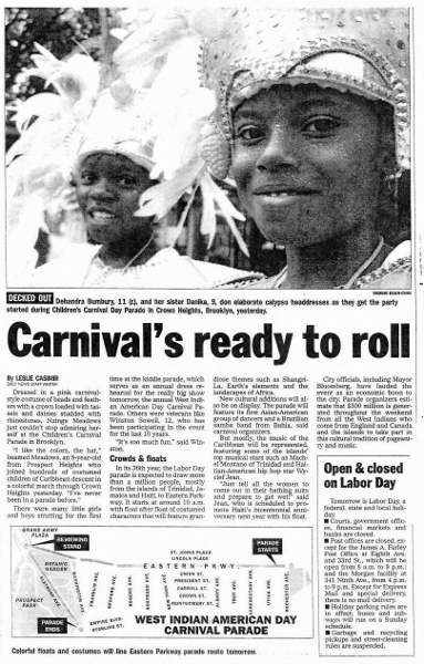 Newspaper Article about 2003 Carnival, showing two girls in costure
