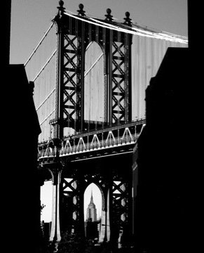Empire State Building framed by the Manhattan Bridge