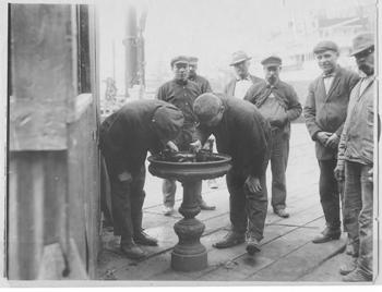 """In line."" One of the drinking fountains at the Bush Terminal. No date."