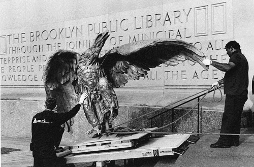 Eagle sculpture being moved into Central Library, 1997