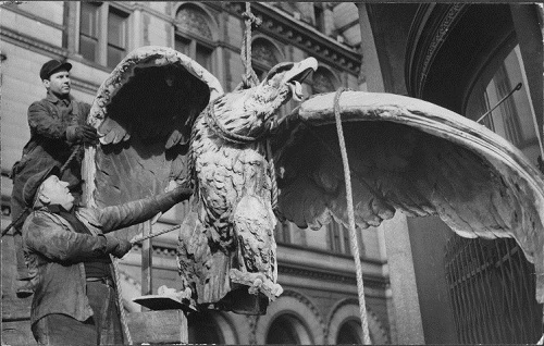 Eagle sculpture being removed from Brooklyn Daily Eagle building, 1955