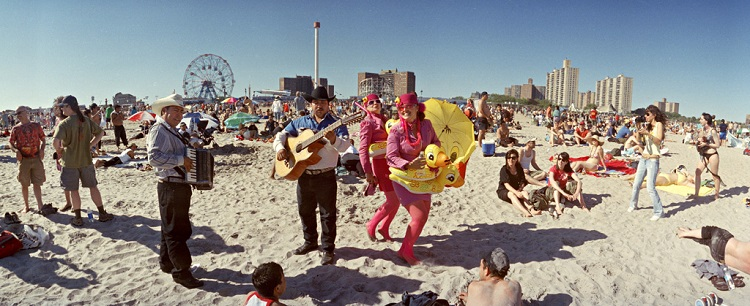 Mexican musicians and mermaids with yellow duck tubes, 2007