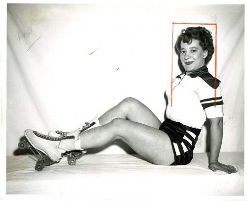 Midge Brasuhn reclining and wearing her skating uniform