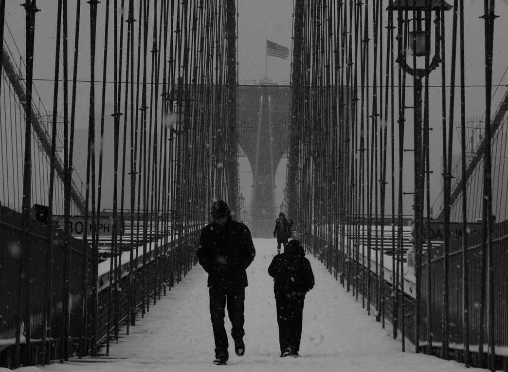 Pedestrians on the bridge in snow