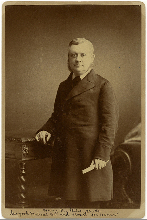 Sepia photo of man in frock coat