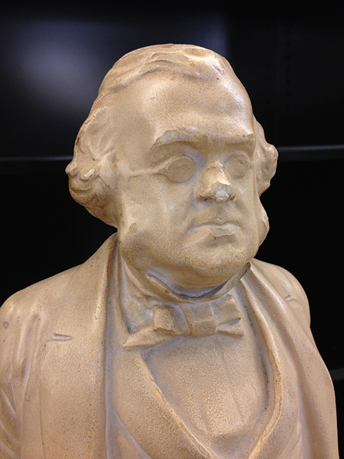 Plaster bust of man with sideburns