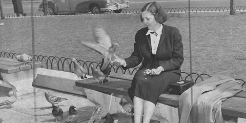 woman holding birds