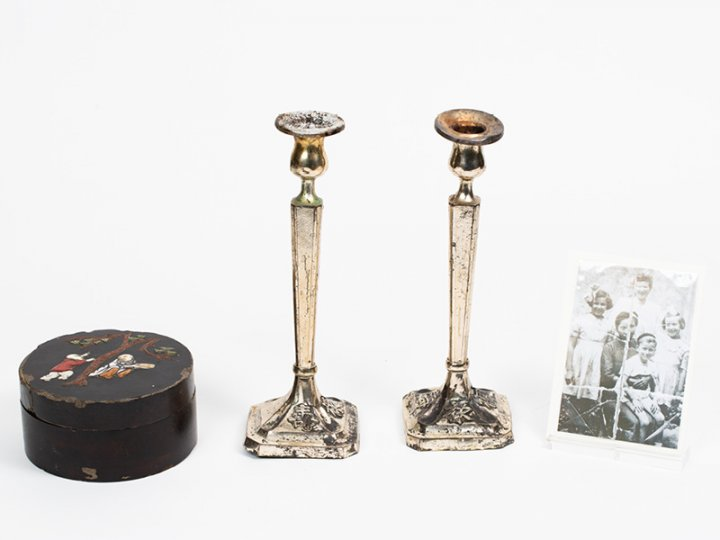 Notion storage box made in Shanghai, China with a pair of silver candlestick holders with Chinese inscriptions and a photo. Candlesticks courtesy of Menachem Shimonowitz, notion box and photo are courtesy of Chaya L. Small, shown here courtesy of Amud Aish Memorial Museum