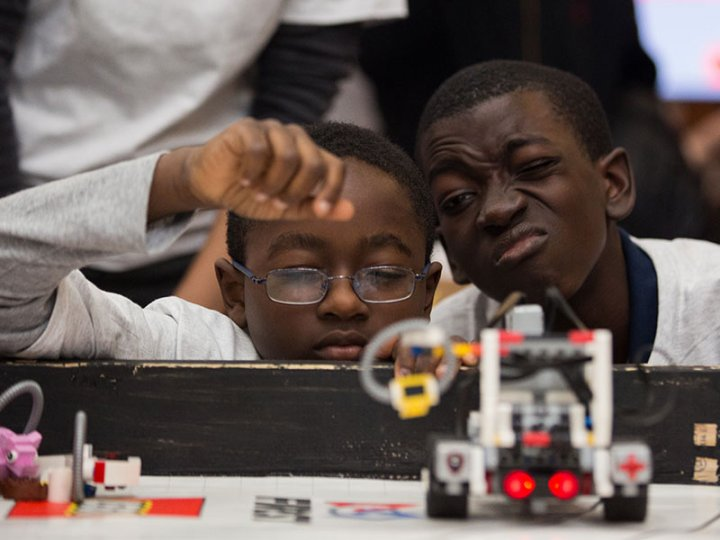 Two participants in the BKLYN Robotics League strategize.