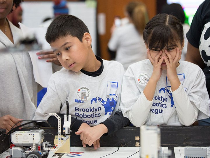 Worried participants compete in the BKLYN Robotics League finals