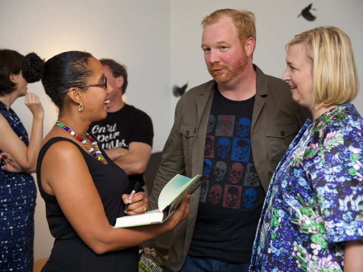 Land of Love and Drowning author Tiphanie Yanique (left) with Small Mercies author Eddie Joyce (center).