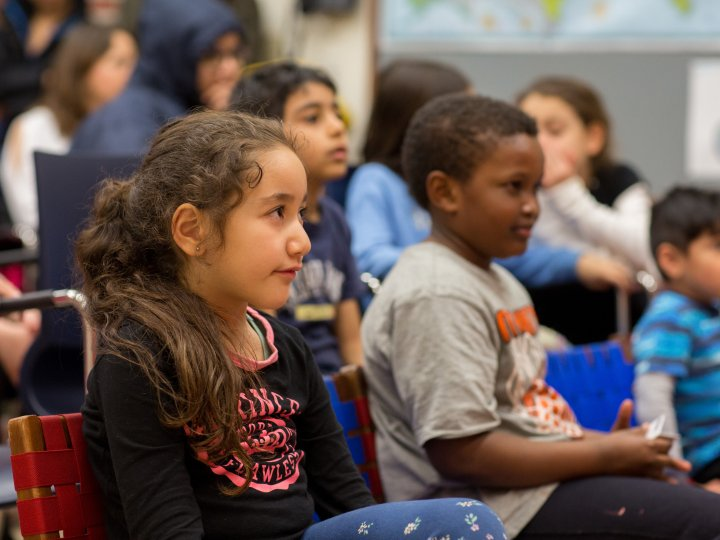 Children watch a puppet show during Fort Hamilton Library.