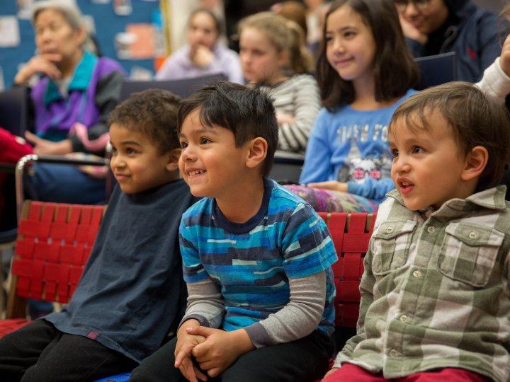 Children laugh during a Fort Hamilton Library program.