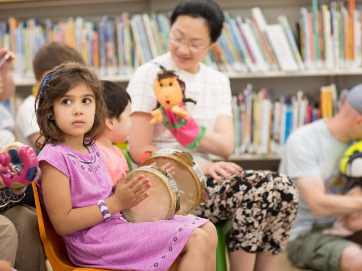 Children watch a puppet show at Bay Ridge Library.
