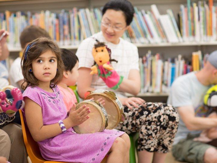 Children watch a puppet show at Bay Ridge Library.