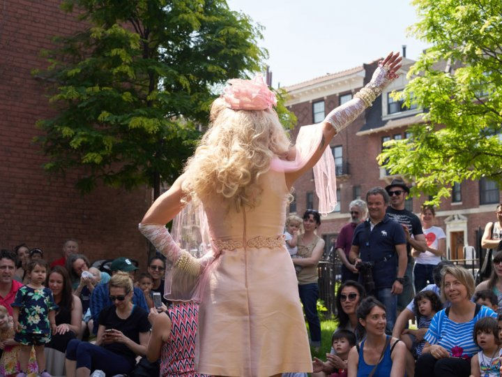 A drag queen greets the crowd during Summer Reading opening weekend 2018.