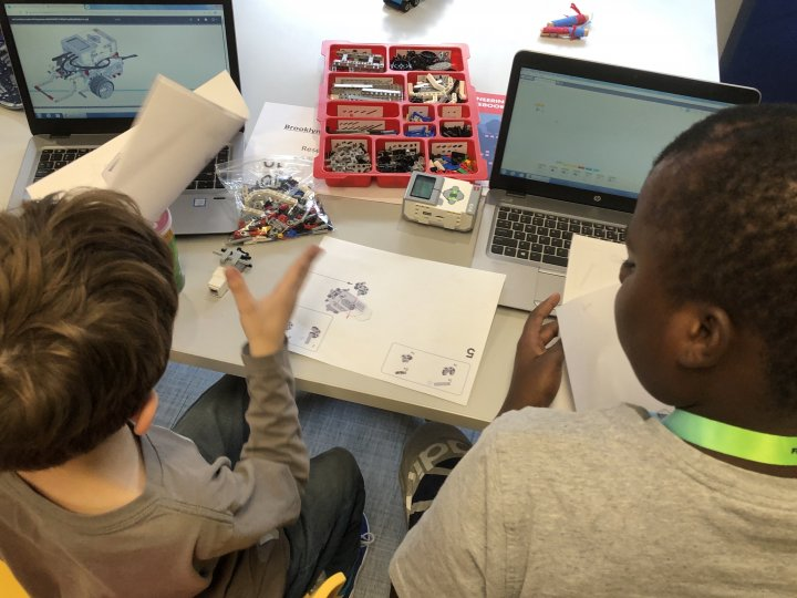 Two boys put together a robot for the Brooklyn Robotics League