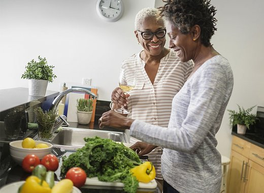Two women preparing healthy meal in the kitchen