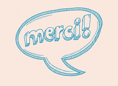 Speech bubble saying 'Merci!'