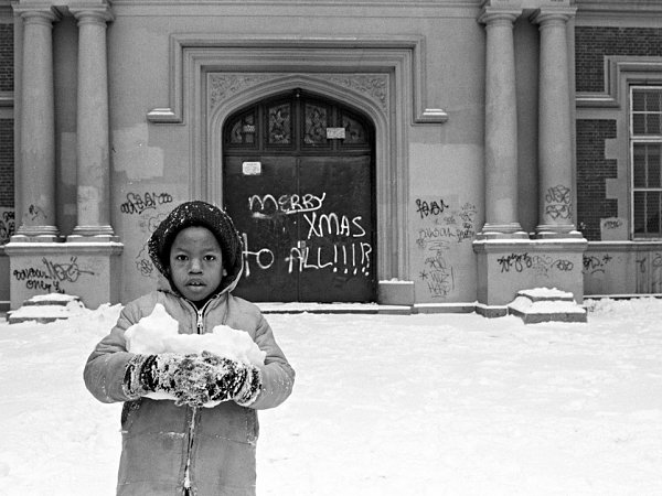 Photo of African American boy holding snow