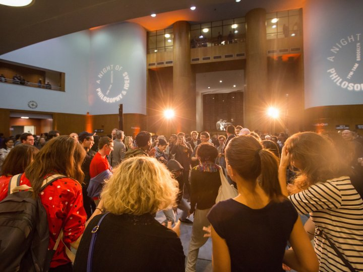 Audience members watch a performance at Night of Philosophy and Ideas